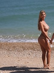 Adrianne Black and Carol Goldnerova whoppers play in the sea