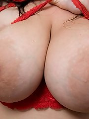 Big tits Stella Fox stripping to display her juggs and holes