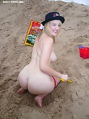 Happy funny blonde teen plays at the beach and exposes her hot big boobs and her wet pink pussy