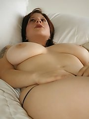 Young sensual Maggy showing off her heavy natural 34 DD's