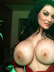 We happily just keep bringing you the best in hot busty babes as we present <b>32GG Dahlia Dark</b> as our very special holiday treat. We